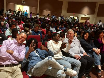Board member, Dan Adams, enjoys time with Carvers Bay High School students during a workshop presented by We've Only Just Begun: A Carpenters Experience.